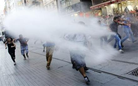 Riot police use water cannons to disperse anti-government protesters in Istanbul