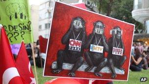ee no evil, speak no evil, hear no evil: A placard pokes fun at Turkish media coverage of Gezi Park